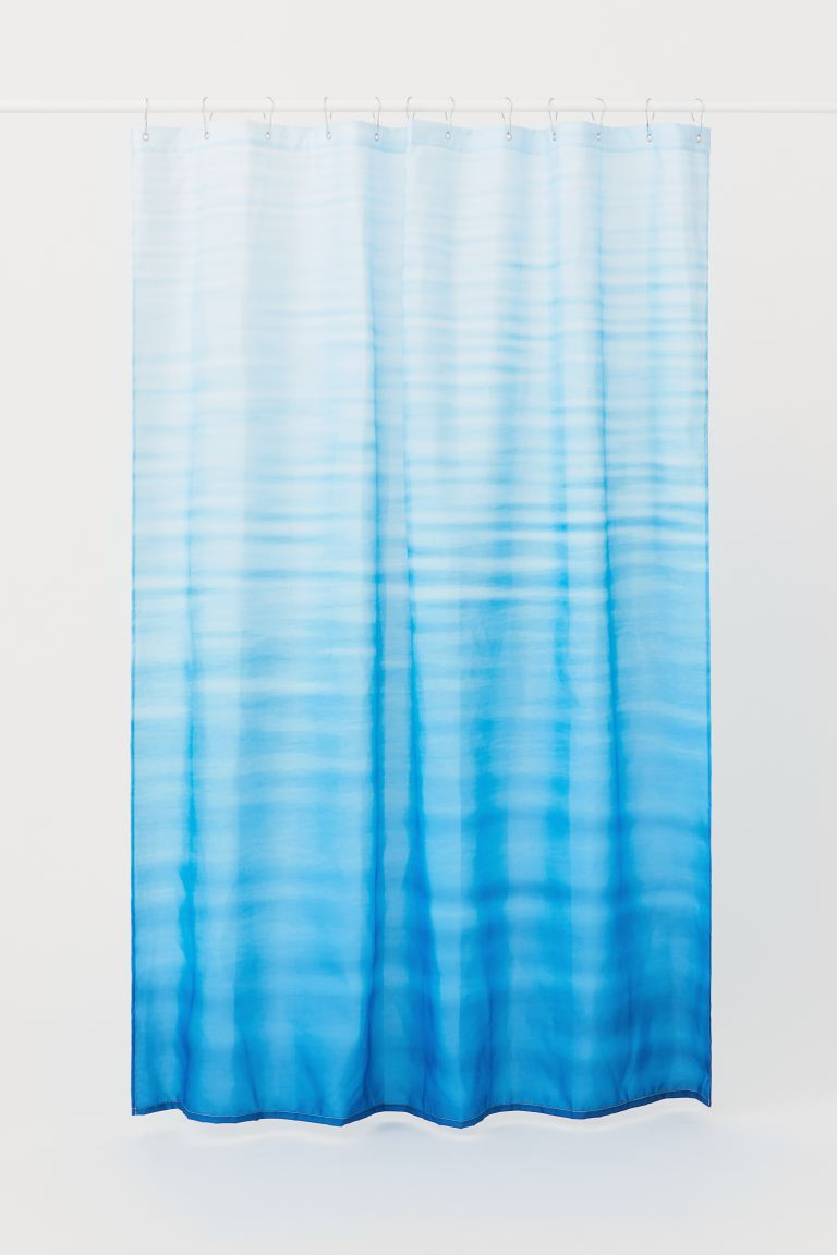 Shower curtain with motif