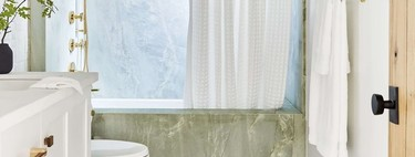 Trend alert;  the latest in bathroom wall tiles are colored marbles and onyx