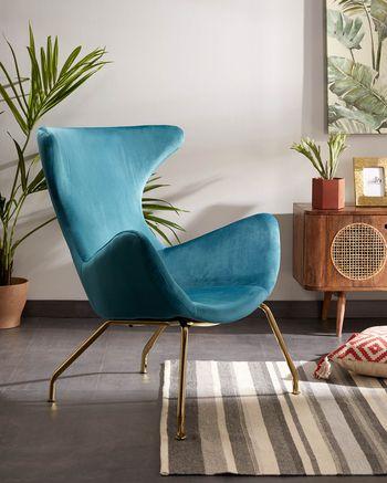 Turquoise velvet armchair